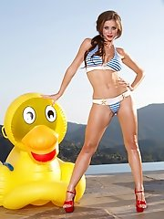 Emily Addison lounges around in pool with her rubber ducky