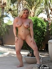 Joanna Thomas enjoys posing and flexing her big beautiful muscles outside on a hot summer day.