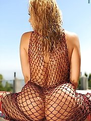Sandy Fantasy in Extreme Pussy Dildo Penetration in Fishnet Poolside